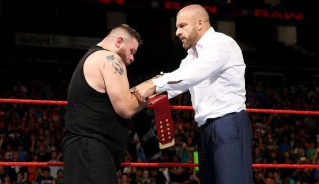 triple-h-hands-the-wwe-championship-to-kevin-owens-on-raw-1474269040-800
