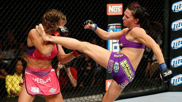 LAS VEGAS, NV - APRIL 13: (R-L) Cat Zingano kicks Miesha Tate in their bantamweight fight at the Mandalay Bay Events Center on April 13, 2013 in Las Vegas, Nevada. (Photo by Josh Hedges/Zuffa LLC/Zuffa LLC via Getty Images)
